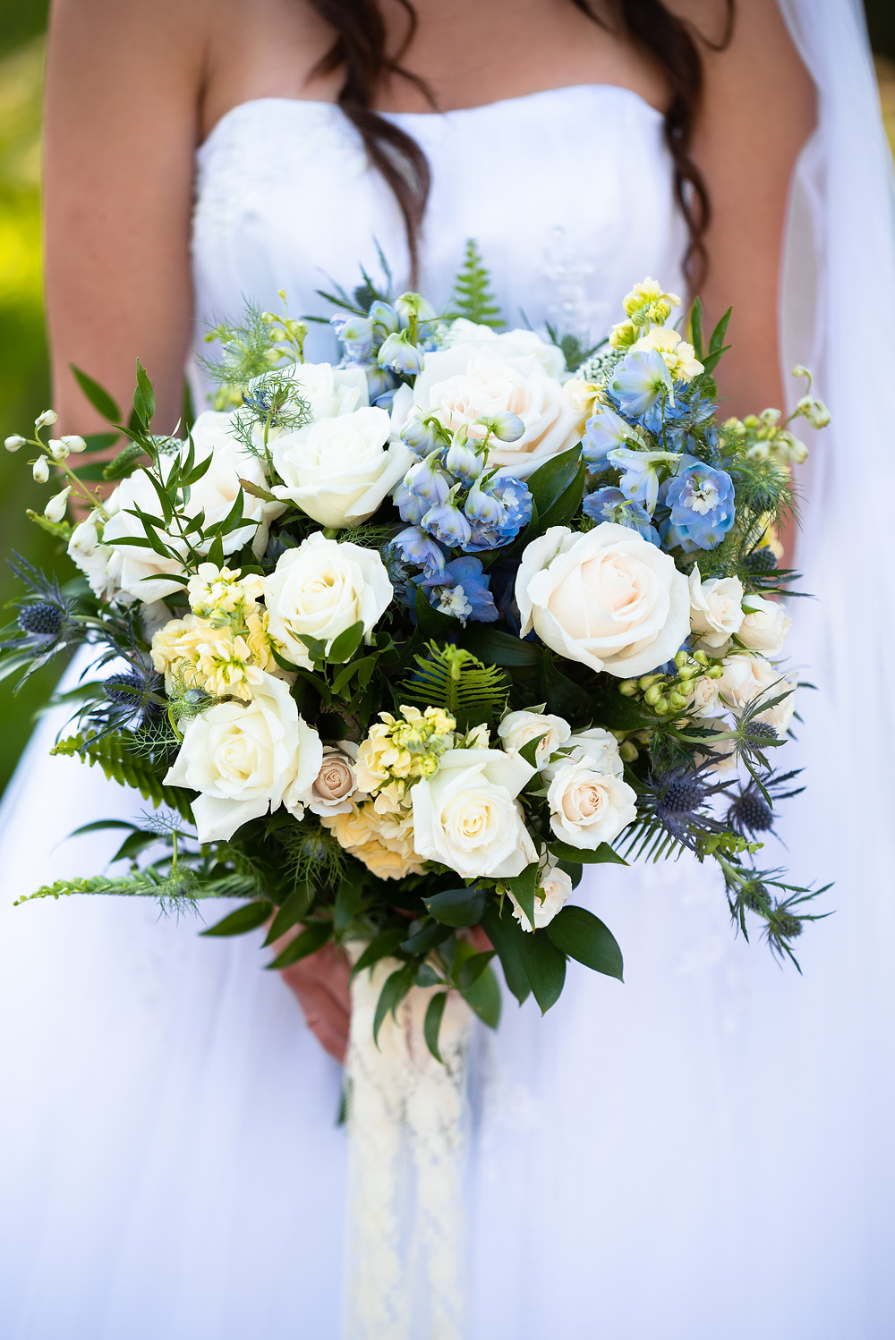 Dusty blue and white wedding bouquet from Conrad Floral in Bigfork, Montana