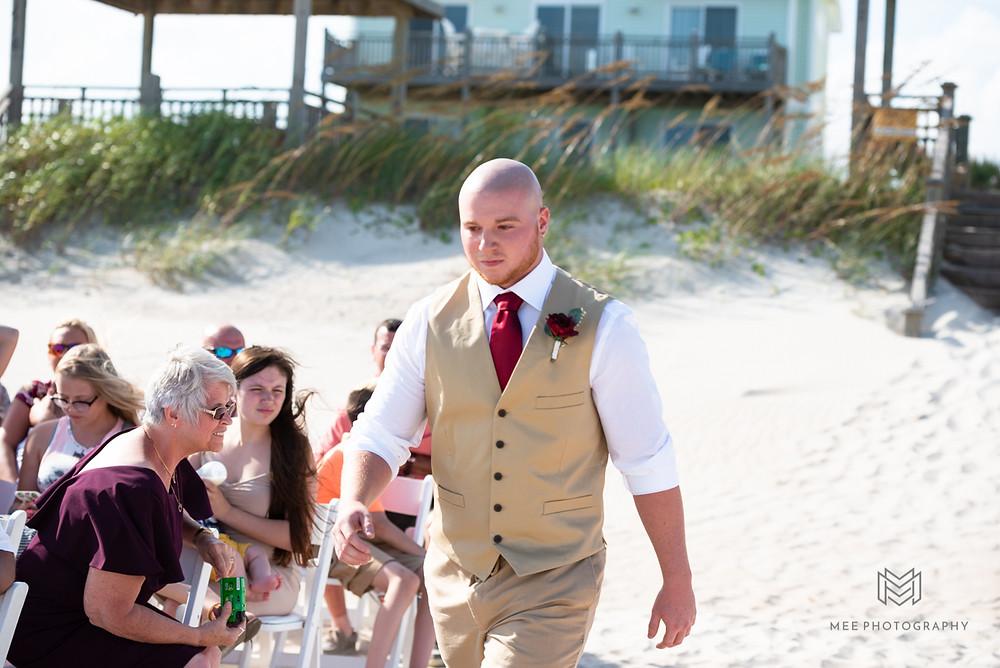 Groom Walking down the aisle on the beach