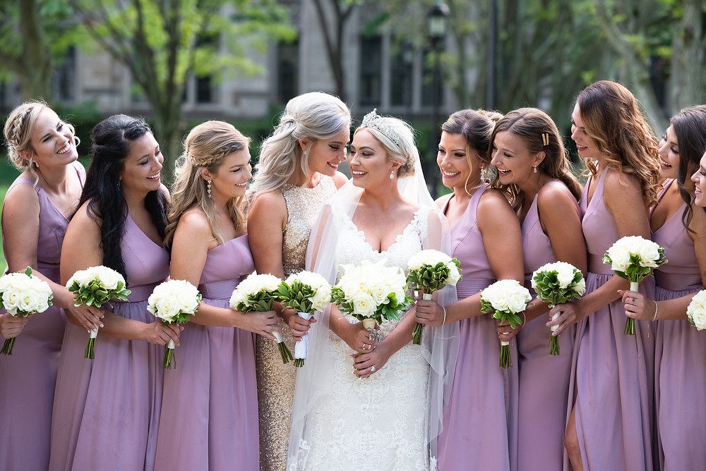 Bride and bridesmaids laughing at Heinz Chapel