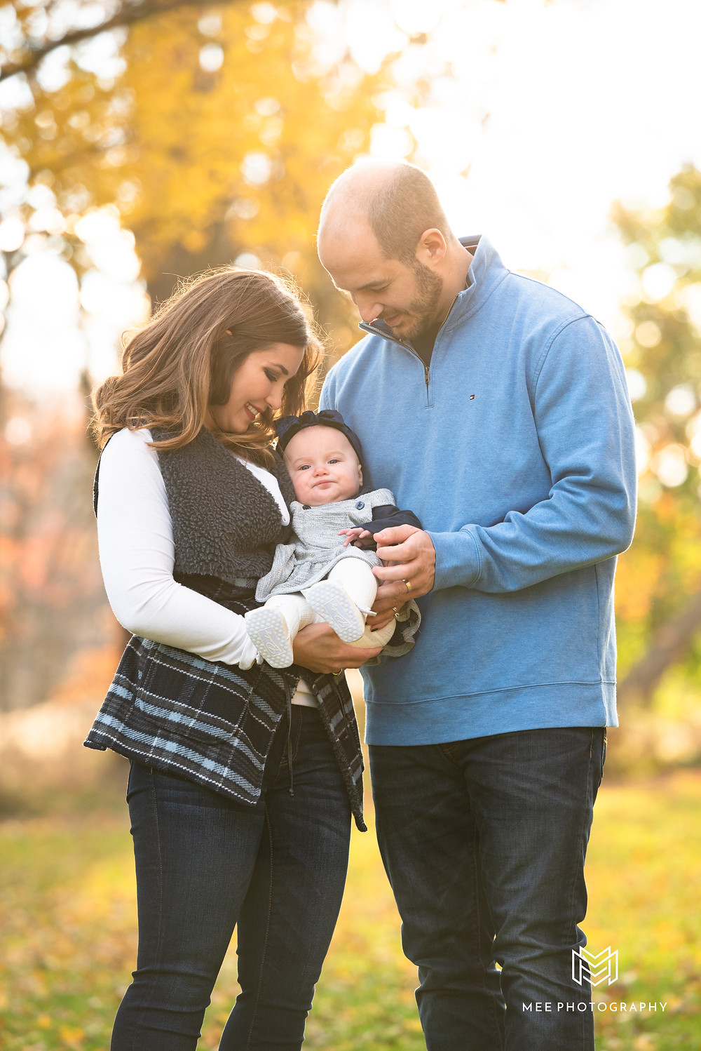 Parents with their baby during a fall photoshoot