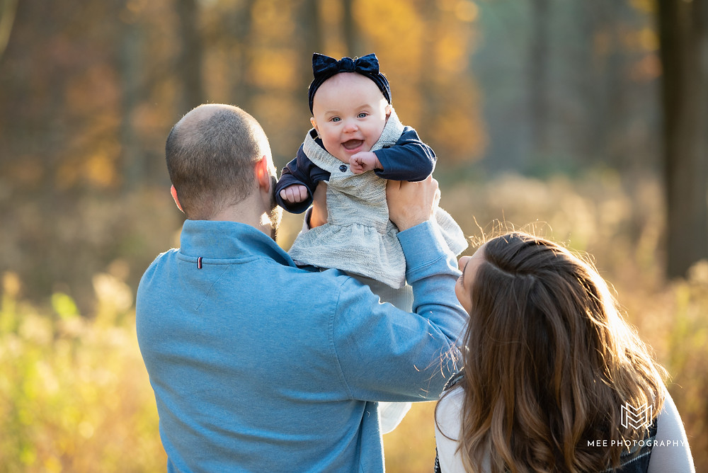 Baby laughing during the family's fall photos