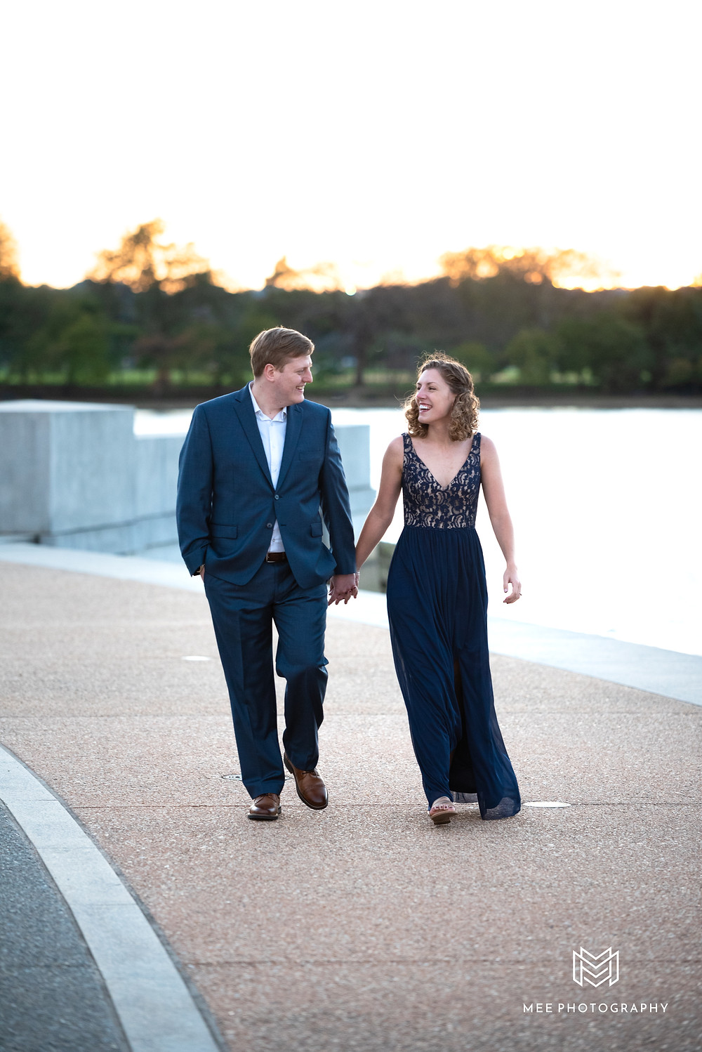 Couple walking and laughing during their Washington, DC engagement photos