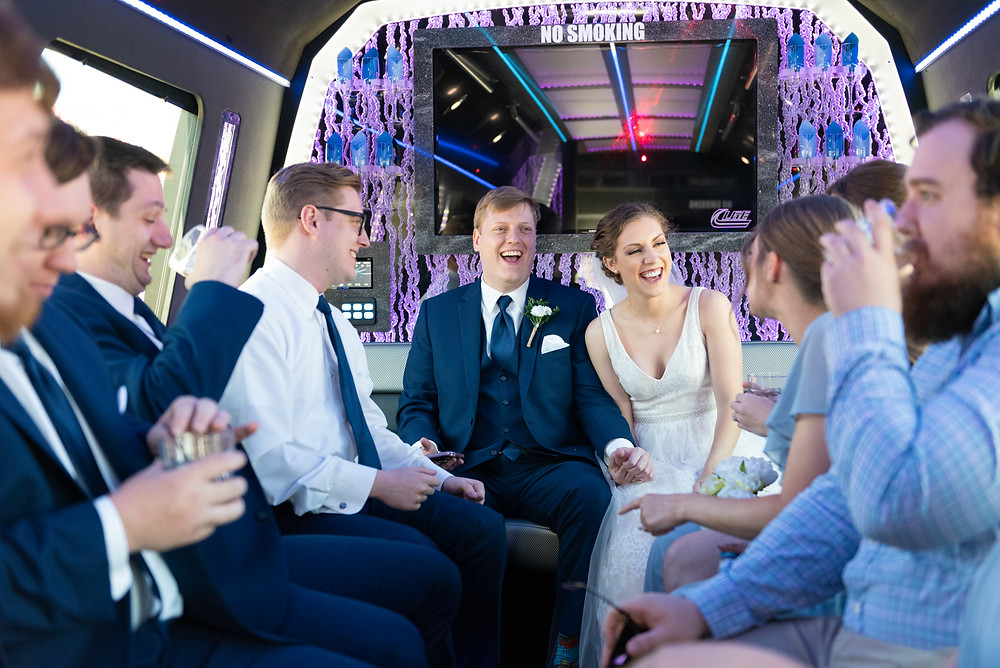 bride and groom partying on the party bus after the wedding