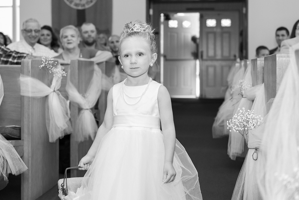 Flower girl forgot to throw the petals