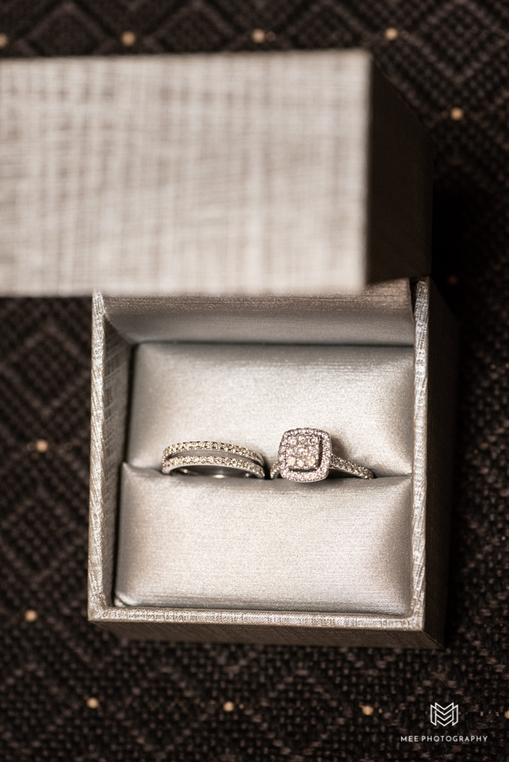 Bride's engagement ring and wedding bands in box