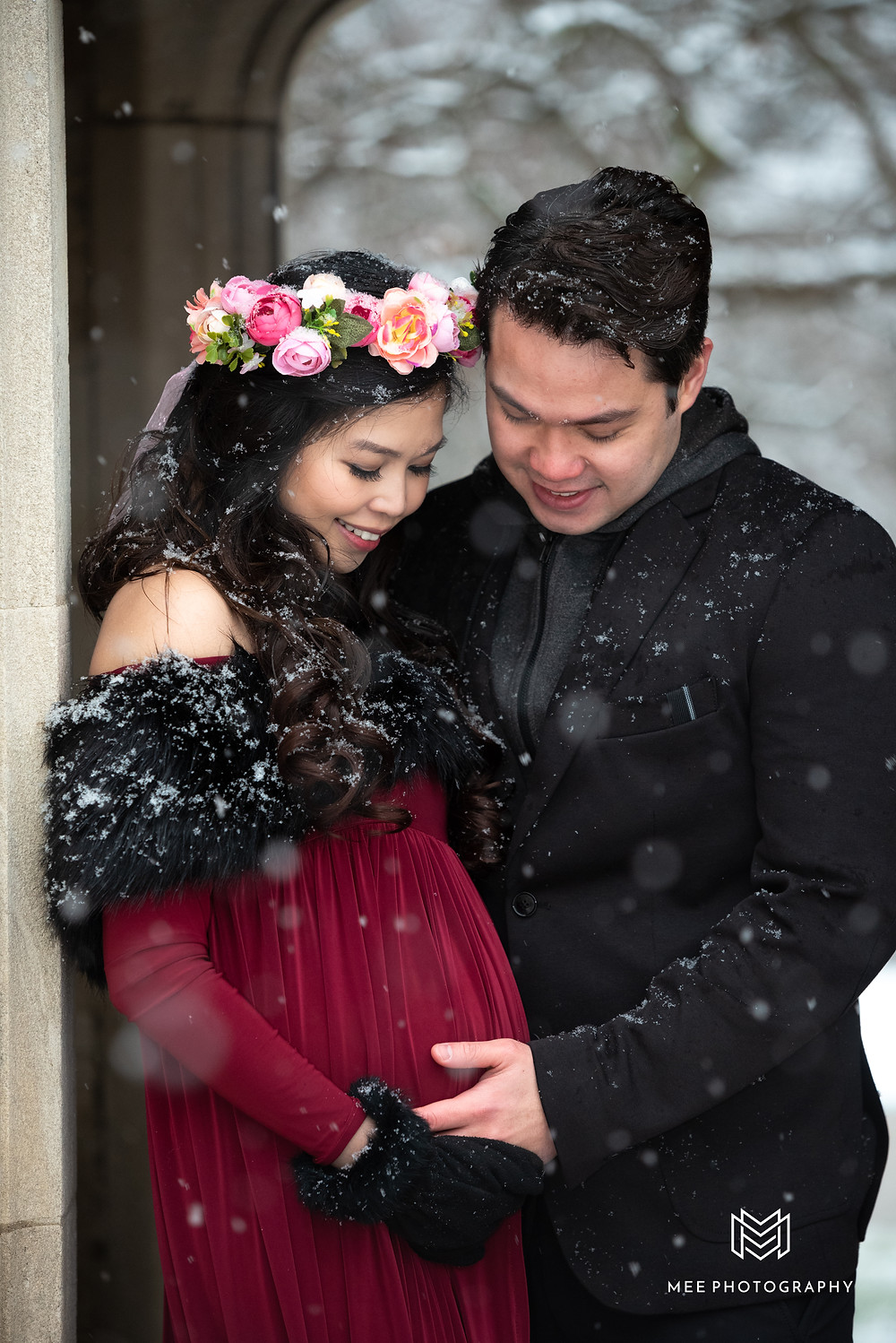 Hartwood Acres winter maternity photos with snow falling