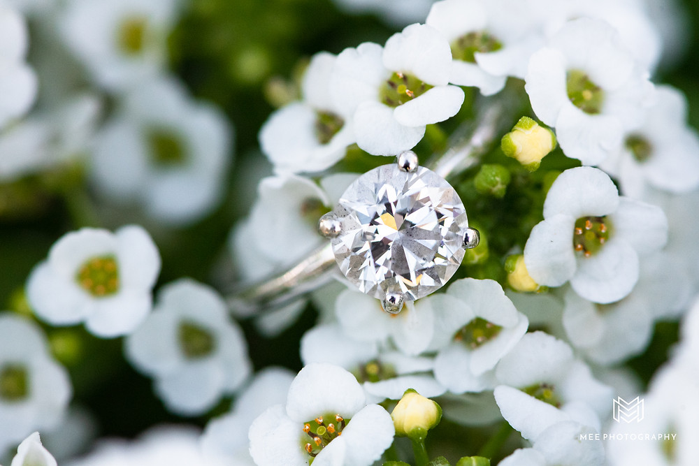 Round diamond engagement ring with silver band