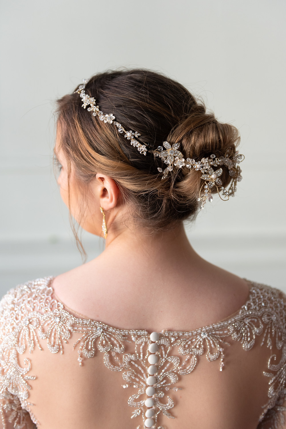 Bridal hair updo with gold head piece