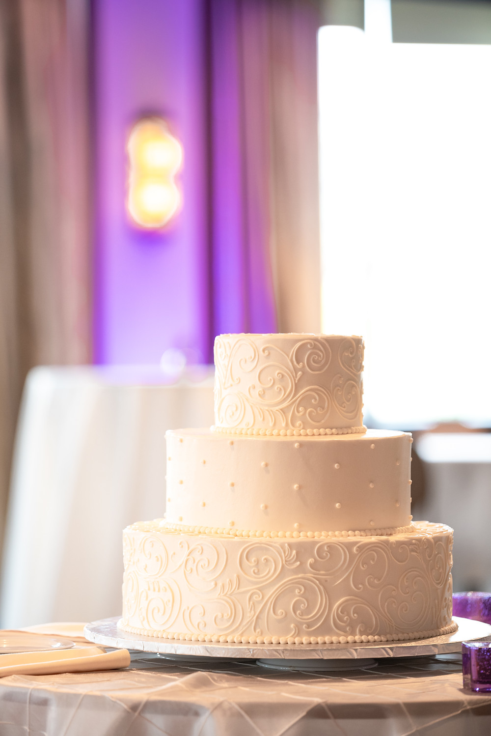 Wedding cake with purple uplighting in the background at the Sheraton in Station Square
