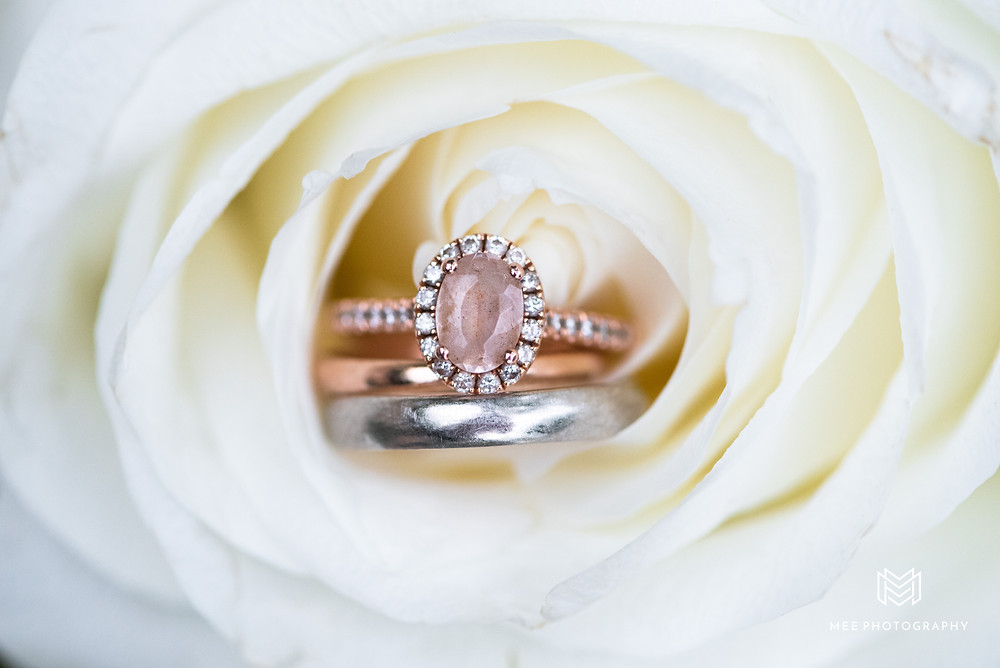 Rose gold oval engagement ring with morganite stone and diamond halo