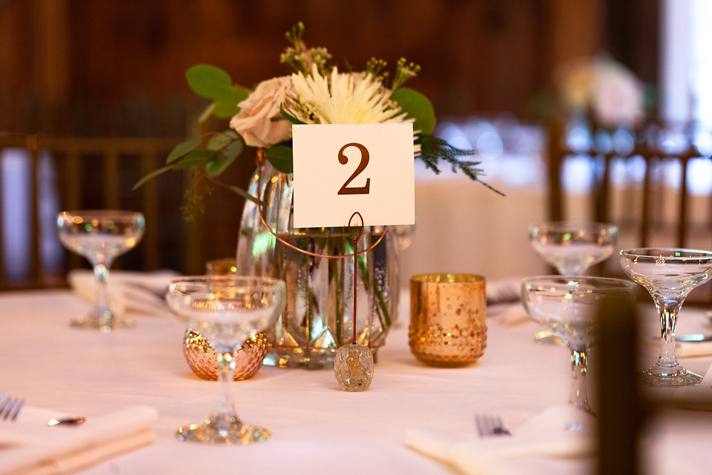 Chanteclaire Farm Table numbers and centerpieces