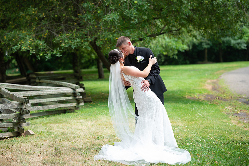Bride and groom portraits during their July wedding