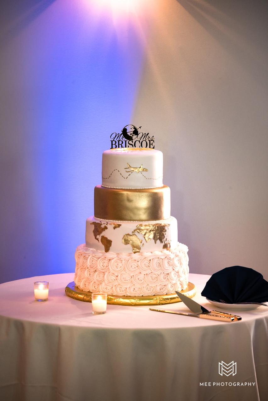 Travel themed ivory and gold wedding cake