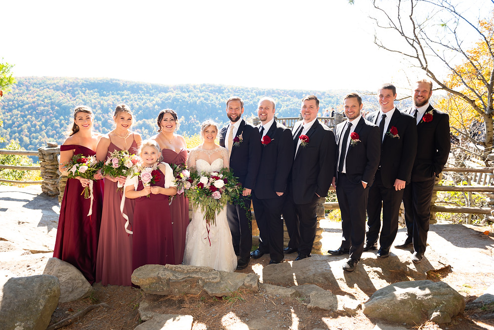 Bridal party portraits outdoors with the rolling hills of WV in the background