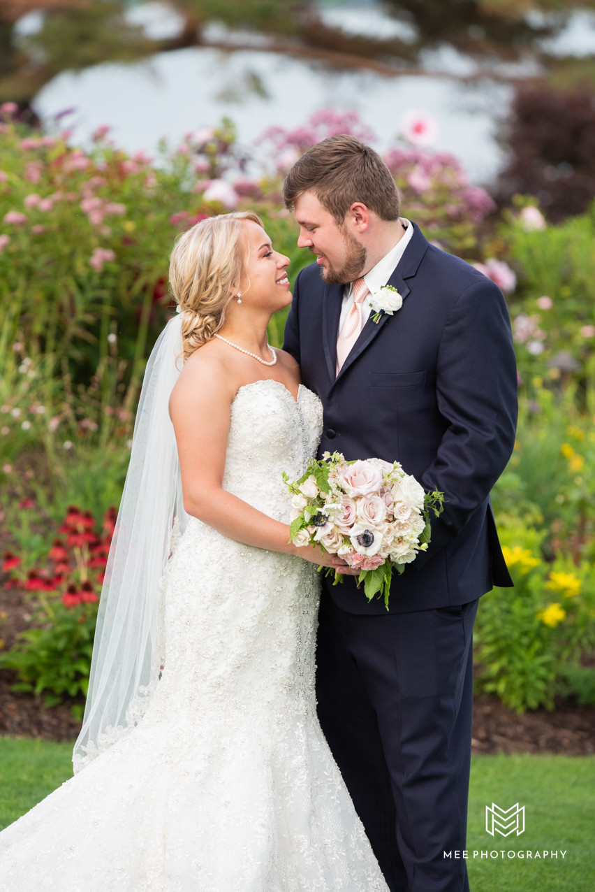 Bride and groom portrait in front of wildflowers