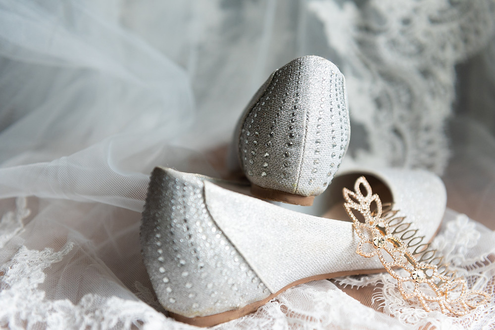 Bride's shoes and veil before wedding