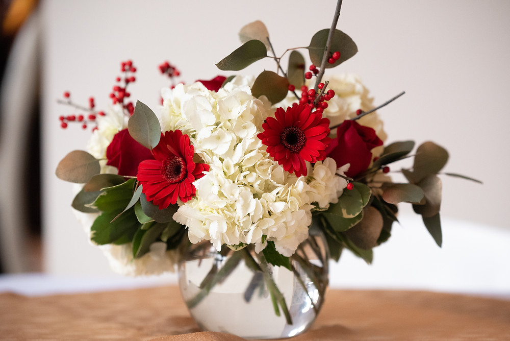 Red and white bridal shower floral centerpiece