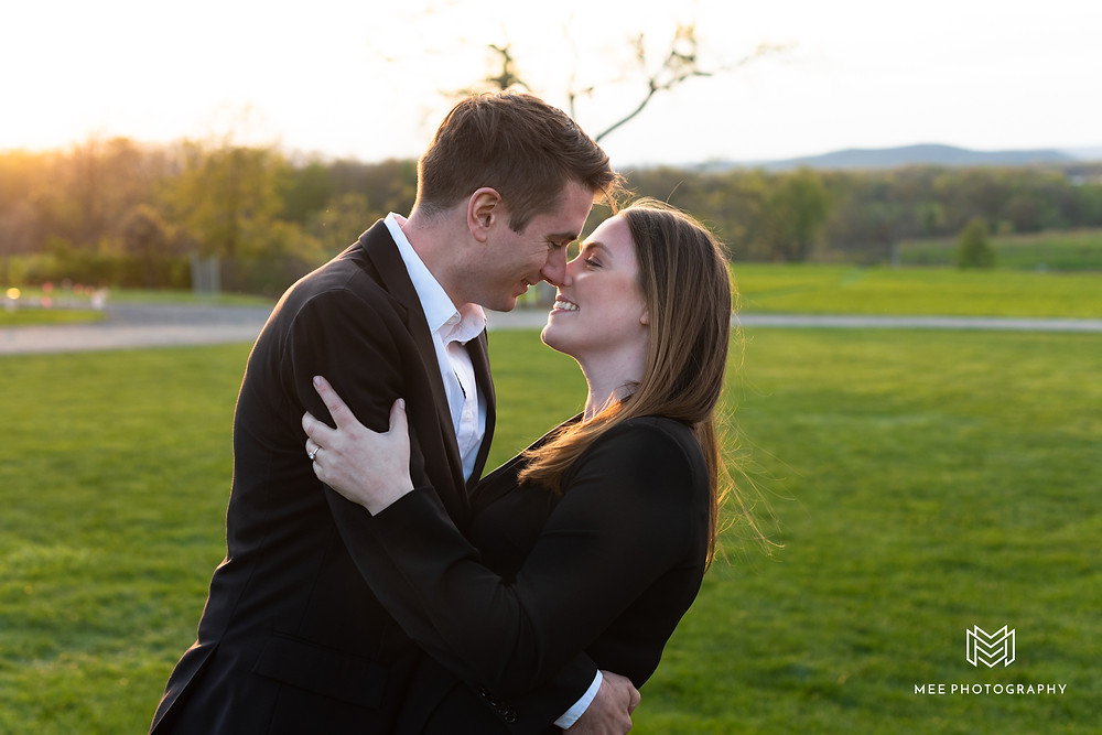 Couple laughing during their photoshoot at Penn State University