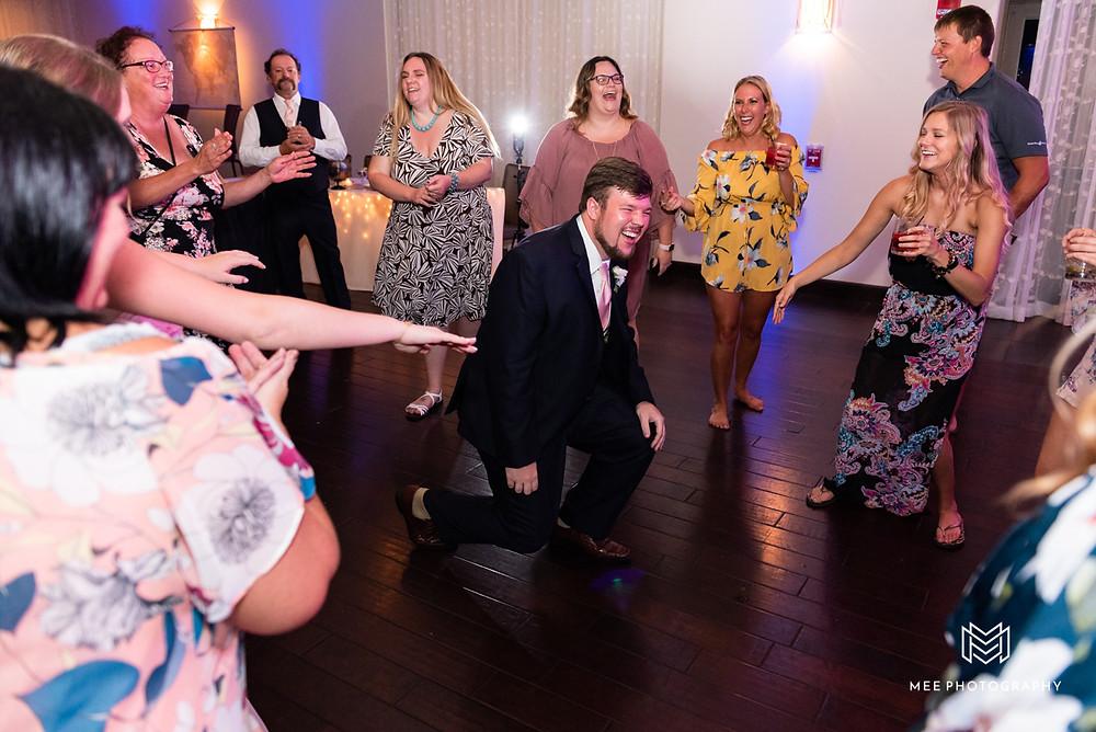 Groom dancing at the wedding reception