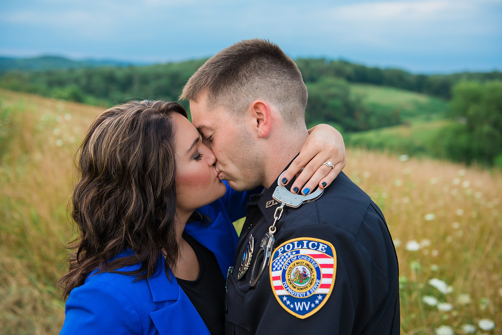 A police themed engagement shoot in a field in New Cumberland, WV.