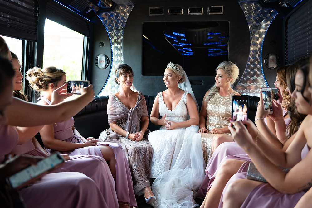Bride and bridesmaids heading to Heinz Chapel in a party bus
