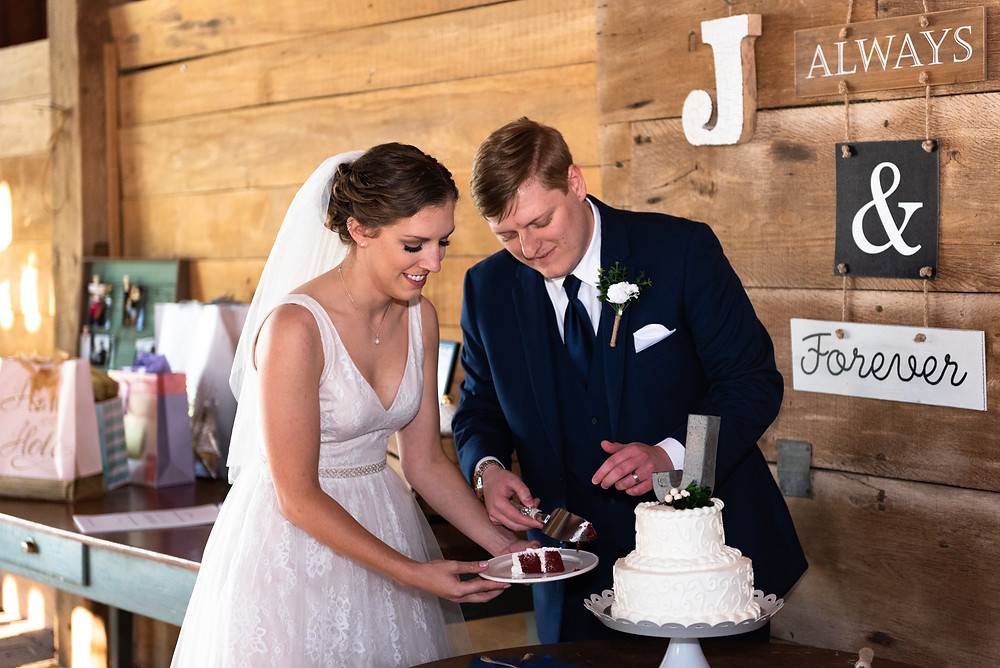 bride and groom cutting their wedding cake at this barn wedding