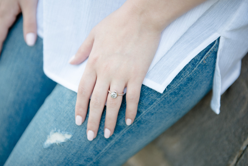 A detail photograph of the bride's engagement ring on her hand.