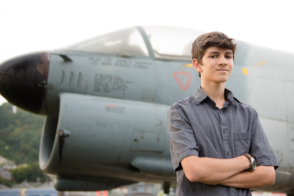 A guy's senior photo session in Weirton, WV. Photograph was taken in front of an airplane.