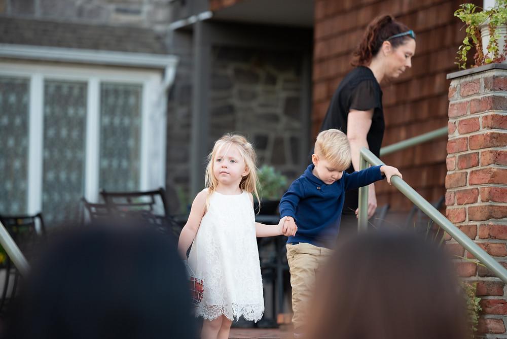 Cute little flower girl and ring bearer walking down the aisle at Morningside Inn