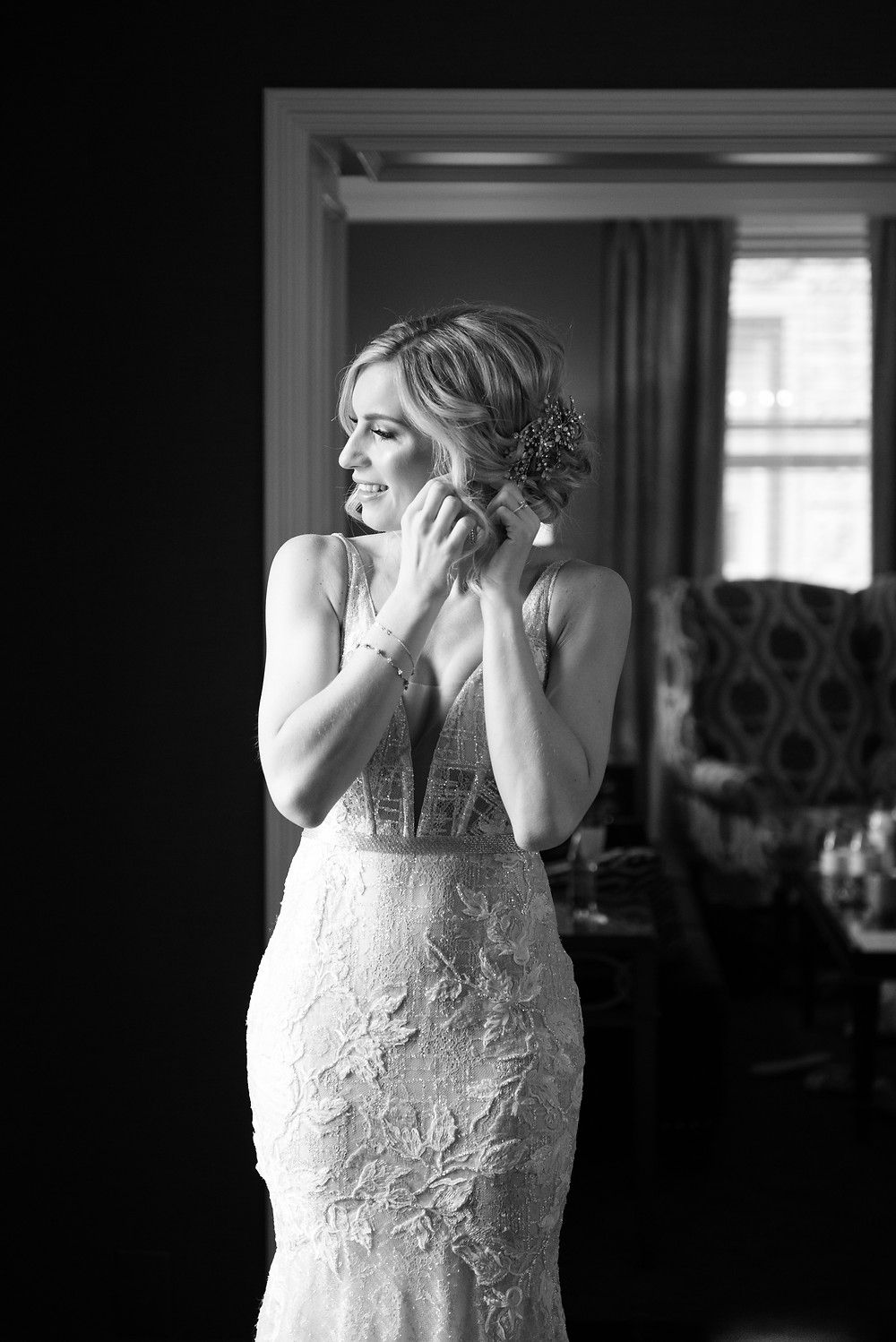 Black and white photograph of bride getting ready at the Omni William Penn Hotel