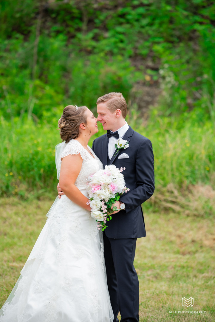 Bride and groom portraits outside on a hot June day