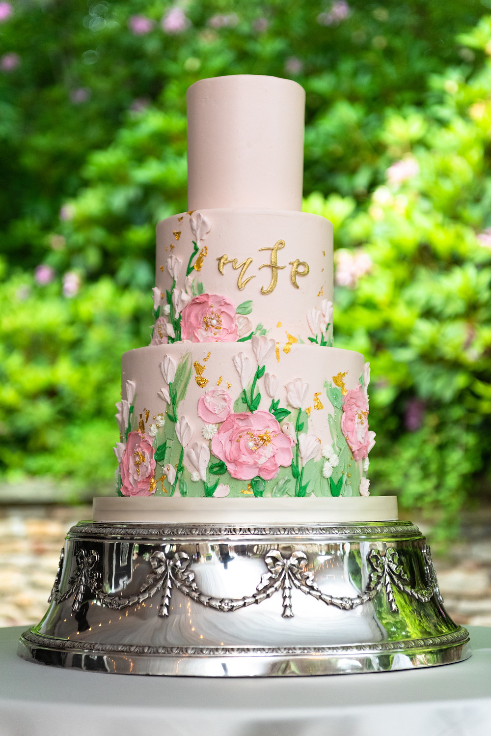 Three tiered white wedding cake with initials and floral details by Tasty Bakery in PA