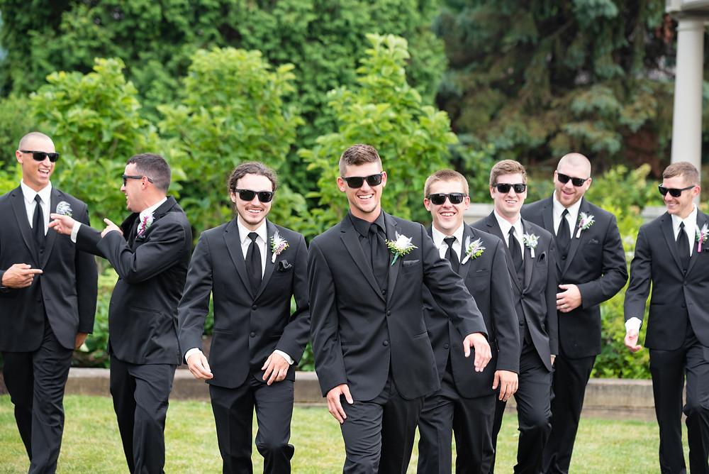 Groomsmen walking and laughing posing idea
