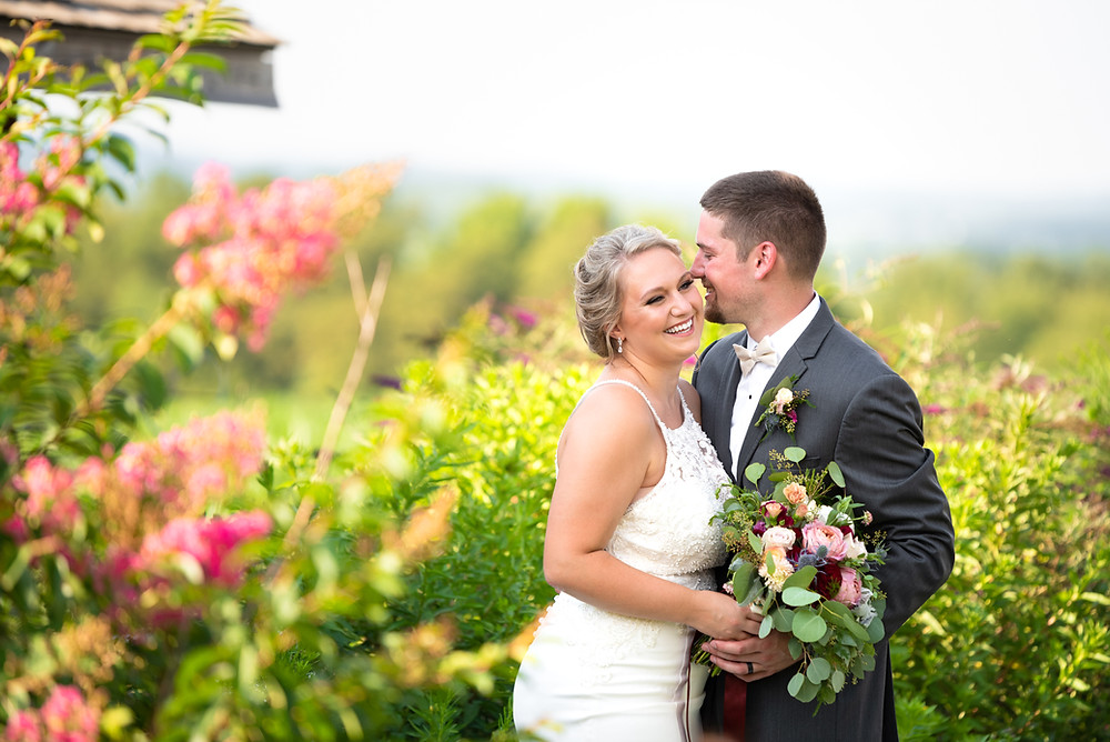 Pittsburgh wedding photographer; bride and groom in a flower garden