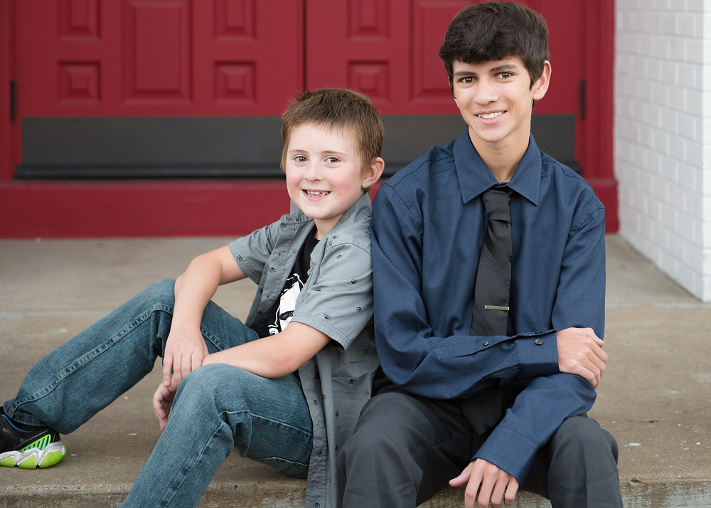 A high school senior with his younger brother during his photo session.