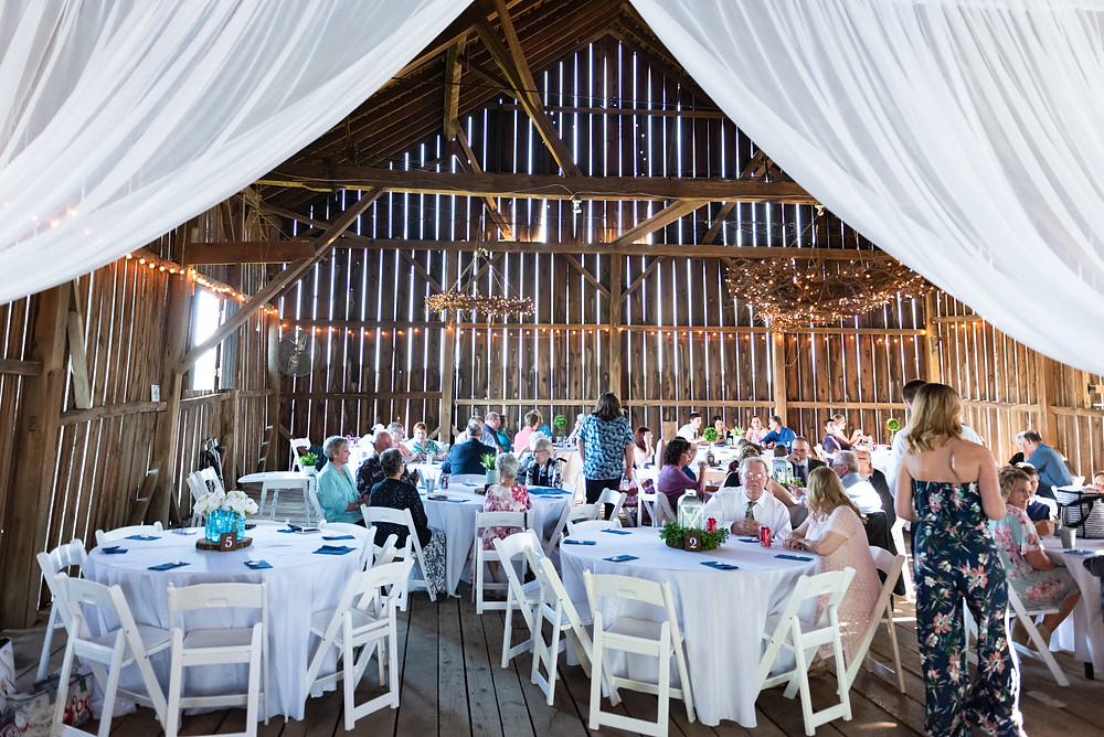 Lewis Family Farms wedding reception with white curtains and table linens