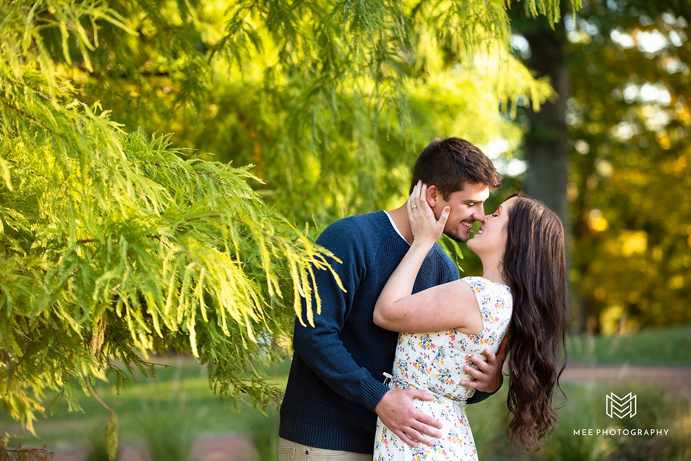 Couple leaning in for kiss during their engagement session at Oglebay Park in Wheeling