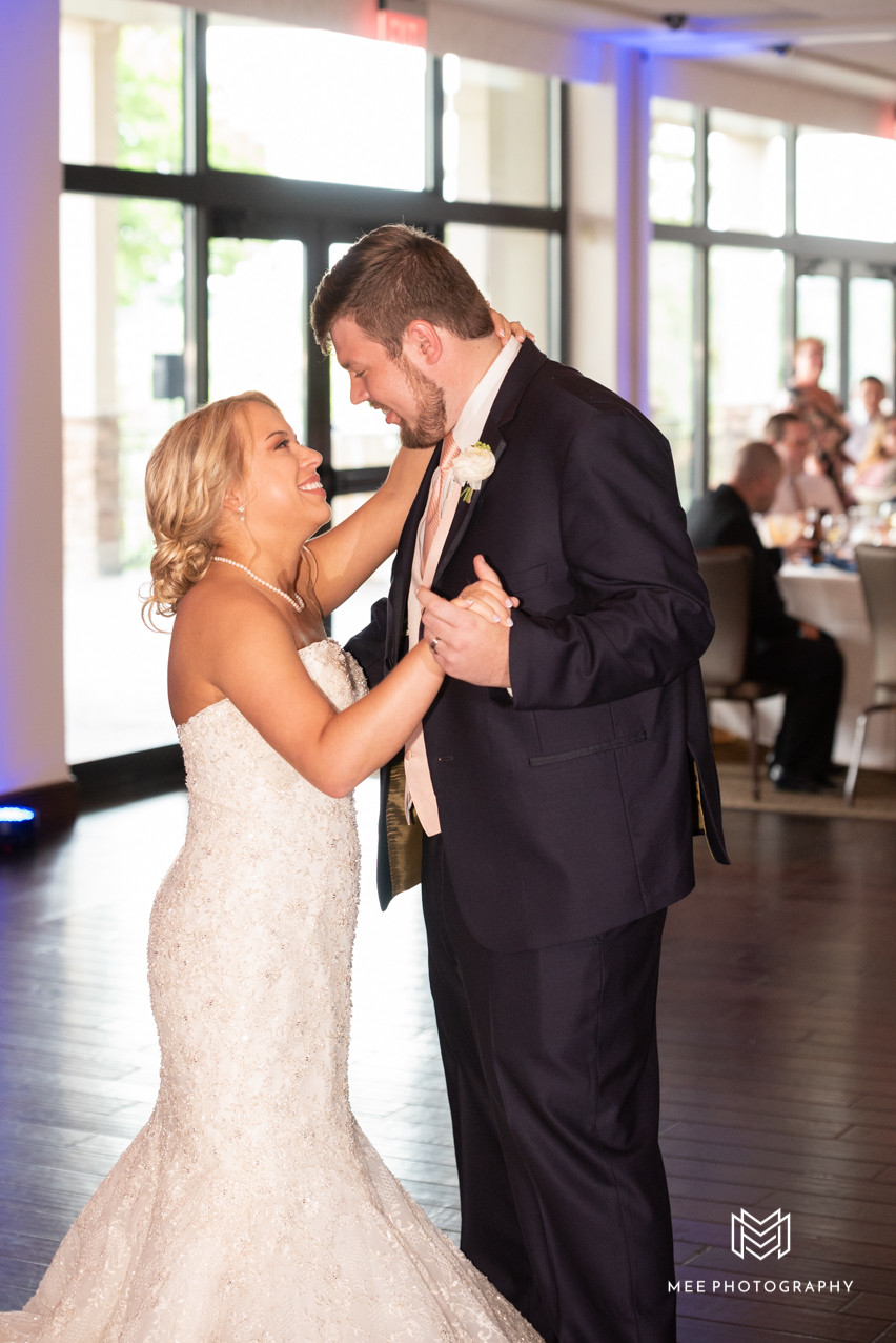 First dance as husband and wife with purple uplighting