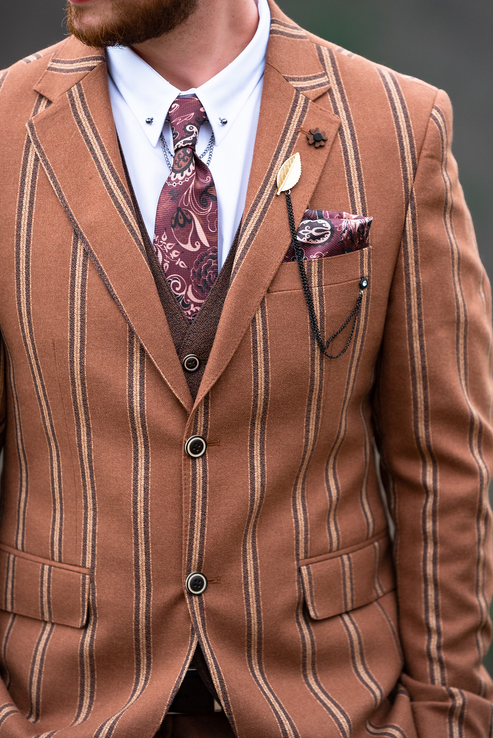 Brown pinstripe suit with paisly tie and pocket square