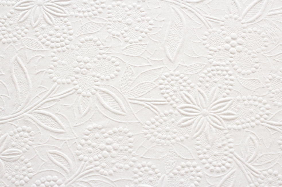 Embossed Floral Pattern on White Paper.j