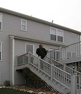 WOODBURY EXTERIOR TRANSFORMATION, BEFORE:  The open deck is functional, but lackluster