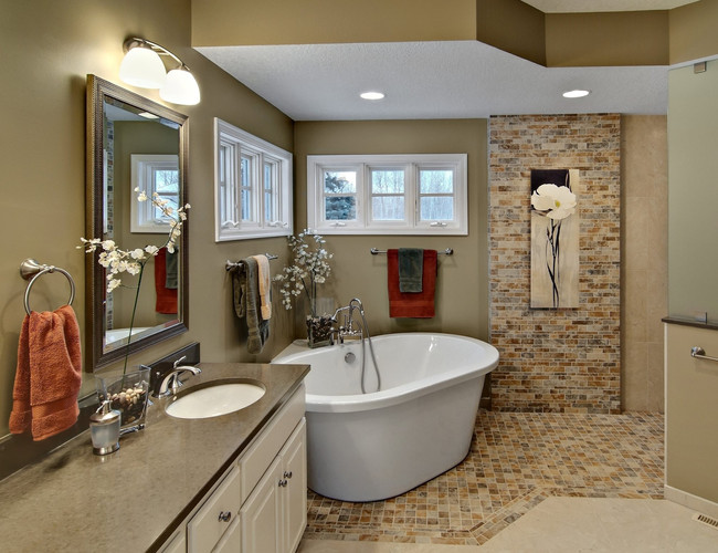 BLAINE MASTER BATH   An elegantly shaped soffit perfectly mirrors the raised tub area in this warm, contemporary bathroom