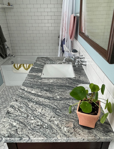 3x6 matte white subway tile with light gray grout adds to the vintage feel