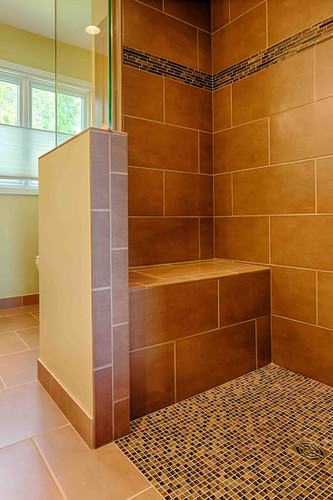 EDEN PRAIRIE BATH  A convenient shower bench offers a safe spot for our aging-in-place clients to sit