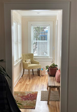 A peak from the existing living room into the new. light-flooded front entry