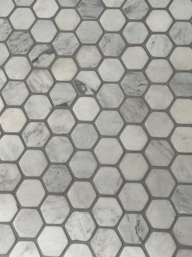 Hexagonal, honed marble  floor tile is the perfect base for this period bath