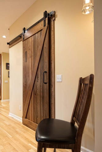 This rustic barn door is the cherry on top of a beautiful design