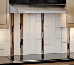 Vertically oriented ceramic and glass tile create a one-of-a-kind backsplash design