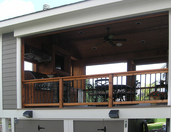 AFTER:   The open deck takes on new life as a gracious outdoor living room