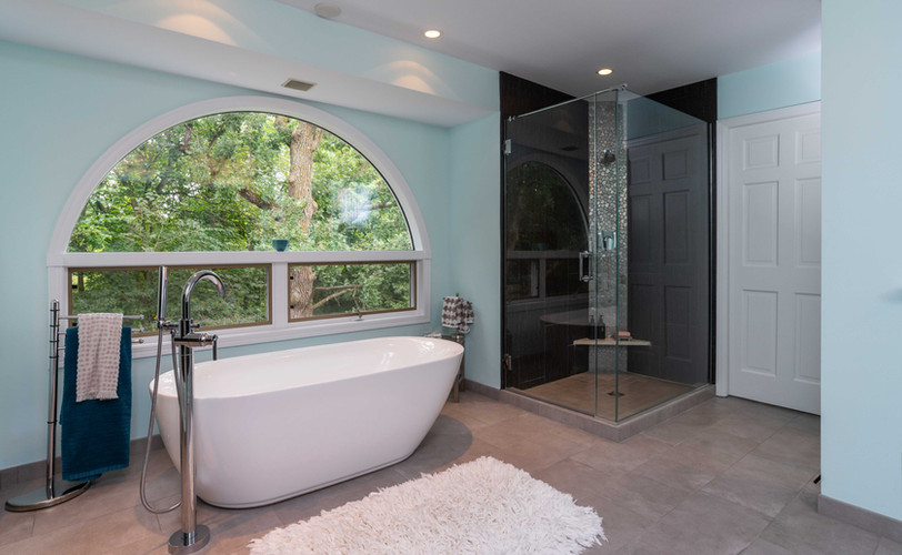 This freestanding tub is a favorite spot for our client to warm up and chill out